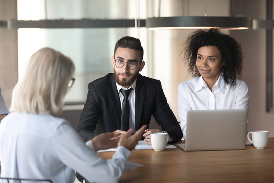 Diverse hr managers listening to mature businesswoman job applicant