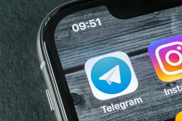 Sankt-Petersburg, Russia, April 11, 2018: Telegram application icon on Apple iPhone X screen close-up. Telegram app icon. Telegram is an online social media network. Social media app