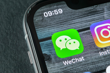 Sankt-Petersburg, Russia, April 11, 2018: Wechat messenger application icon on Apple iPhone X smartphone screen close-up. Wechat messenger app icon. Social media network.