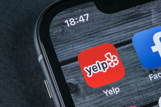 Sankt-Petersburg, Russia, April 12, 2018: Yelp application icon on Apple iPhone X screen close-up. Yelp app icon. Yelp.com application. Social network. Social media
