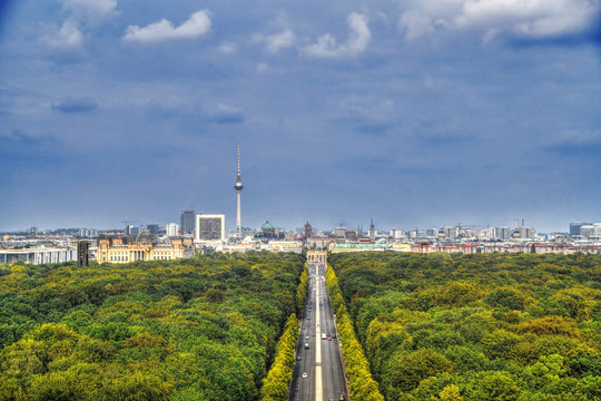 Beautiful aerial HDR image of the skyline of Berlin including its mail attraction: the Reichstag, Brandenburg Gate, Tv Tower in Alexanderplatz, Berlin Cathedral and Tiergarten