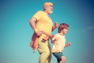Healthcare run lifestyle. Grandfather and grandson jogging. Senior man and child in family health...
