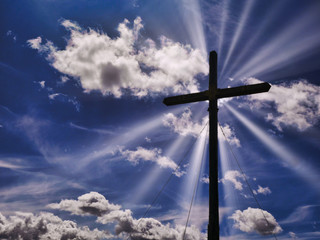 Cross silhouette sunbeam symbol christianity heaven concept