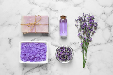 Flat lay composition with natural cosmetic products and lavender flowers on marble background