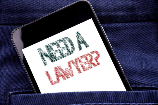 Handwriting Announcement text showing Need A Lawyer. Business concept for Advocacy Justice Help Written phone mobile phone, cellphone placed in man front jeans pocket.