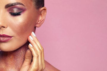 Sexy young woman with glitter makeup on pink background, closeup. Space for text Wall mural