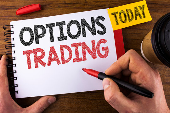 Conceptual hand writing showing Options Trading. Business photo text Options trading investment commodities stock market analysis written by Man Notepad holding Pen Wooden background Today Cup