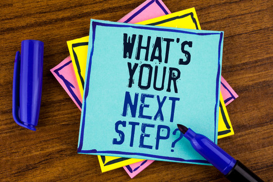 Handwriting text writing What iS Your Next Step Question. Concept meaning Analyse ask yourself before taking decisions written Sticky note paper wooden background Marker next to it.