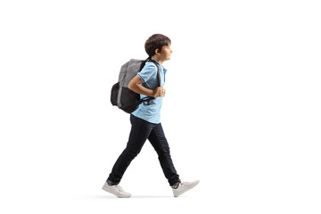 Schoolboy with a backpack walking Fotomurales