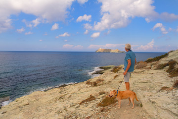 Man standing at coast from Corsica