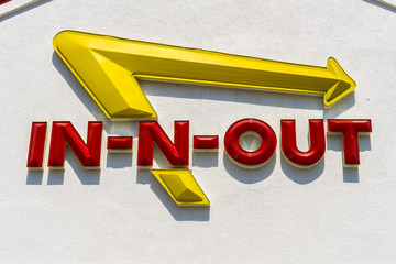 September 4, 2018 San Jose / CA / USA - Close up of In-N-Out logo displayed above the entrance to one of their locations in south San Francisco bay area