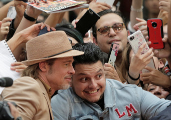 """Brad Pitt poses for a photo with a fan during the red carpet for """"Once Upon a Time in Hollywood"""" in Mexico City"""