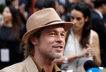 "Brad Pitt talks to reporters during the red carpet for ""Once Upon a Time in Hollywood"" in Mexico City"