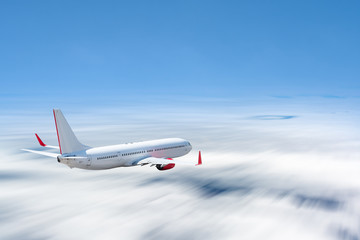 White airplane flying above cloud at daytime with motion blur effect Fototapete