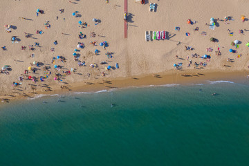 Tuinposter Luchtfoto People on vacation on beautiful beach, Praia da Luz, Algarve, Portugal, summer aerial drone wide view