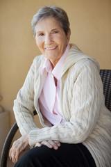 Portrait of a mature elderly woman smiling.