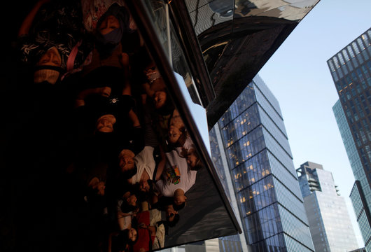People wait in line ahead a tour the inside 'The Vessel,' a large public art sculpture made up of 154 flights of stairs at the Hudson Yards development, a residential, commercial, and retail space on Manhattan's West side in New York City