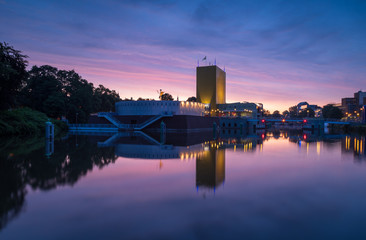 A colorful dawn at a canal in the city center of Groningen, Holland.