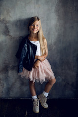 fashionable girl model in a leather jacket skirt and shoes