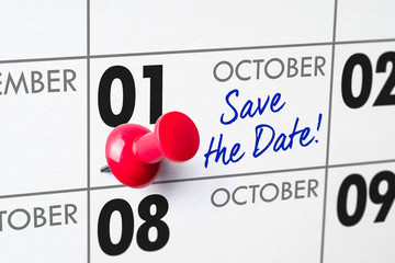 Wall calendar with a red pin - October 01