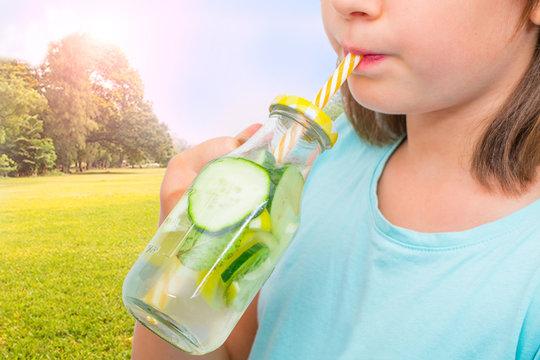 children drinking fresh water fruit with straw