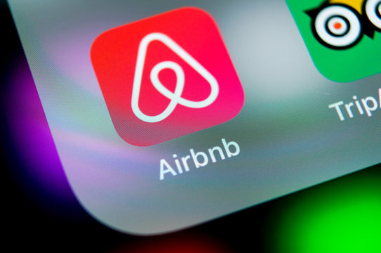 Sankt-Petersburg, Russia, August 16, 2018: Airbnb application icon on Apple iPhone X screen close-up. Airbnb app icon. Airbnb.com is online website for booking rooms. social media network.
