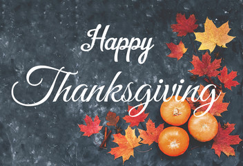 Fototapete - Happy Thanksgiving greeting card with maple leaves, pumpkins, cinnamon and  anise.