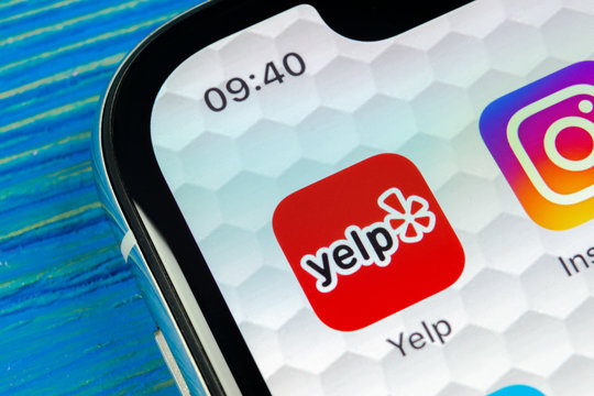 Sankt-Petersburg, Russia, June 20, 2018: Yelp application icon on Apple iPhone X screen close-up. Yelp app icon. Yelp.com application. Social network. Social media