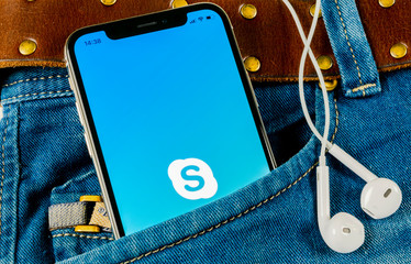 Sankt-Petersburg, Russia, April 14, 2018: Skype application icon on Apple iPhone X smartphone screen in jeans pocket. Skype messenger app icon. Social media icon. Social network. Skype app icon.