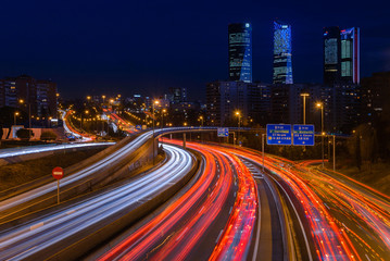 Fotobehang Nacht snelweg M30 highway at night with Madrid skyline (Four towers business area) as background, Spain