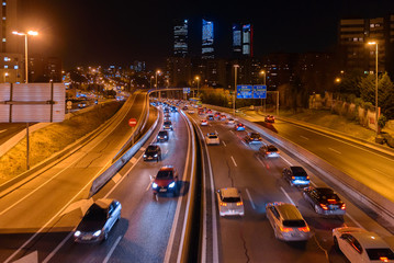 In de dag Nacht snelweg M30 highway at night with Madrid skyline (Four towers business area) as background, Spain