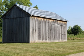 A side view of the old wood barn in the countryside.