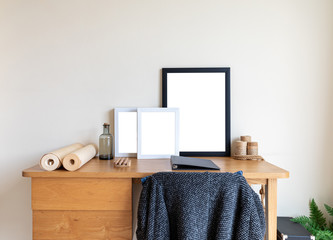 Office desk with white space photo frame