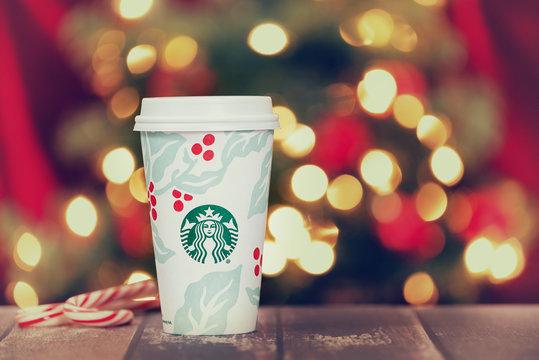 Starbucks popular holiday beverage displayed with candy canes against Christmas tree background on November 5, 2018 in Dallas, Texas