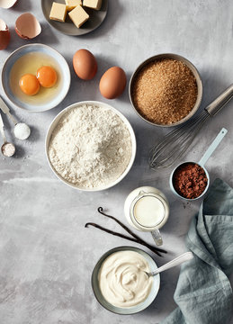 Baking ingredients: flour, eggs, sugar, butter, milk and spices