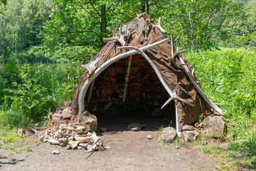 Fototapeta Hut or hovel made of animal skins and bones. Reconstruction of the human home of the Stone Bronze Age.
