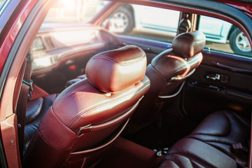Burgundy leather luxury interior in business class car