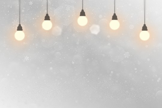 nice sparkling glitter lights defocused bokeh abstract background with light bulbs and falling snow flakes fly, festive mockup texture with blank space for your content