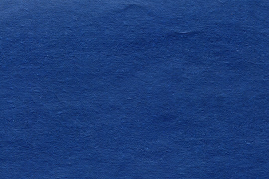Textured blue paper background