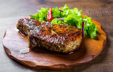 Pork Loin chops marinated meat Steak with vegetables slad on wooden table background Wall mural