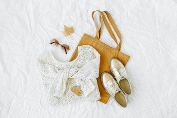 Wall Mural - Knitted white sweater with shoes and tote bag. Autumn/winter fashion clothes collage on white background. Top view flat lay.