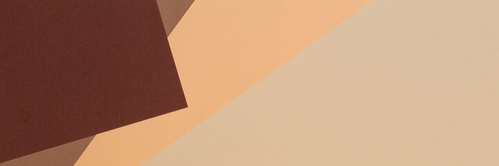 Color papers geometry composition banner background with beige, light brown and dark brown tones.
