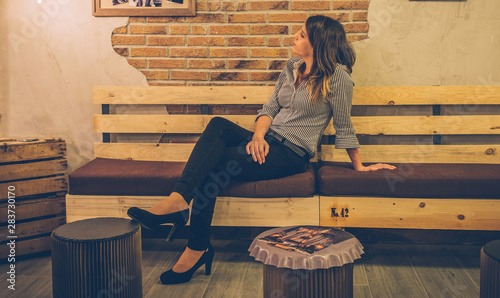 Sensational Elegant And Stylish Young Woman Pensive Sitting On Wooden Ocoug Best Dining Table And Chair Ideas Images Ocougorg