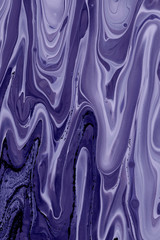 Blurred abstract background. Mixing different colors of paint. Toning purple. Cropped shot, vertical, close-up, no people, free space. Design concept.