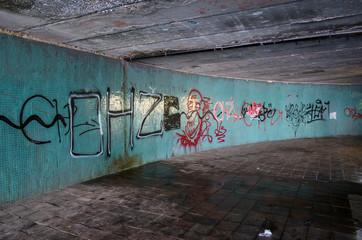 graffiti on wall in underpass