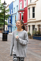 Portrait young smiling girl with a smoothie