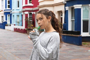 Portrait young girl with a smoothie