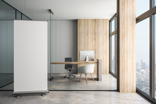 Blank white poster in modern office at glass wall background.