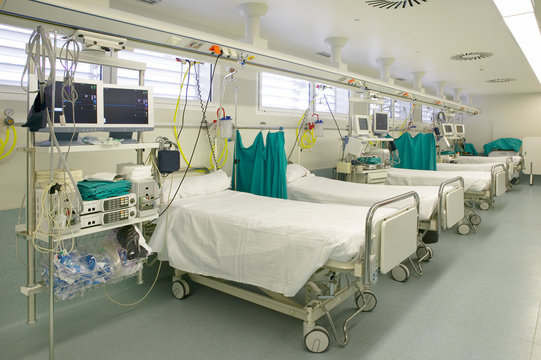 Hospital intensive care unit with beds equipment. Health center