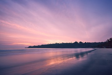 Beach at colorful sunrise
